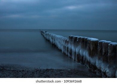 frozen groins at beach of Baltic sea in winterseason
