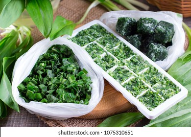 Frozen Herbs on a wooden background