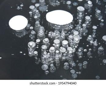 Frozen ice bubbles in frozen lake