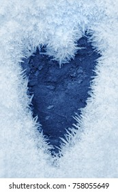 Frozen ice crystals on the ground a heart shape, for backgrounds or textures