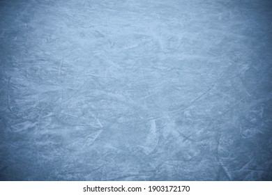 Frozen ice skating surface as background. Winter season