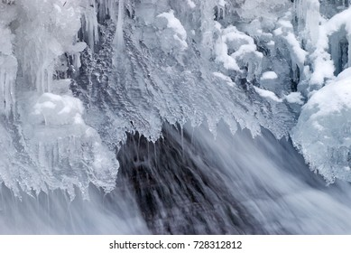 Frozen ice waterfall on the rock