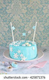 Frozen Inspired Blue and White Snowflake Cake