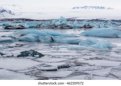 Frozen Jokulsarlon glacier lake lagoon. Vatnajokull National Park. Iceland.