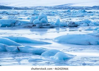 Frozen Jokulsarlon glacier lake lagoon on sunset. Vatnajokull National Park. Iceland.
