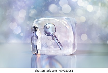 Frozen key in an ice cube. 3D illustration with blur. Front view with space for text.