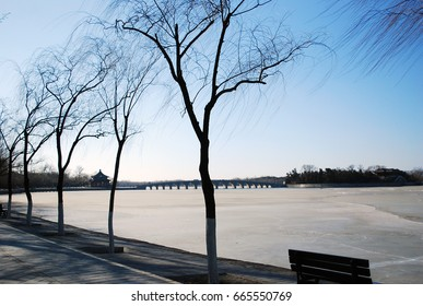 The frozen Kunming Lake at the Summer Palace ringed with willows in Beijing in winter.