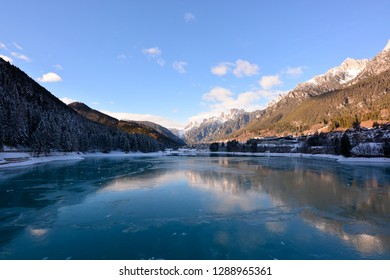 the frozen lake after a very cold night, in the Belluno Dolomites, in Auronzo
