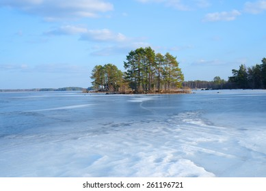 Frozen lake landscape in spring