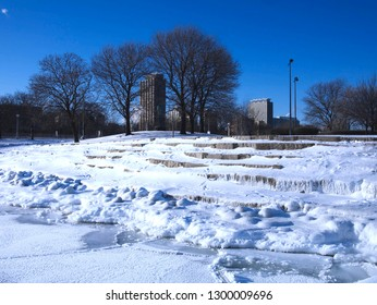 Frozen Lake Michigan with sheet of ice and snow during polar vortex in Chicago, Illinois