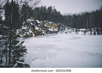 Frozen lake in the middle of woods