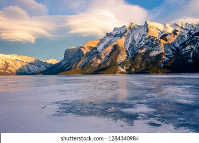 Frozen Lake Minnewanka and Mount Girouard in the Golden Hour, Banff National Park, Alberta, Canada - Winter Landscape