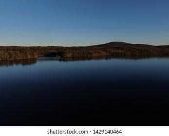 A frozen lake near the white bridge Rutland Massachusetts