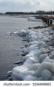frozen lake on the riverside