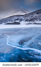 A frozen lake in the Rocky Mountains of Canada in Alberta