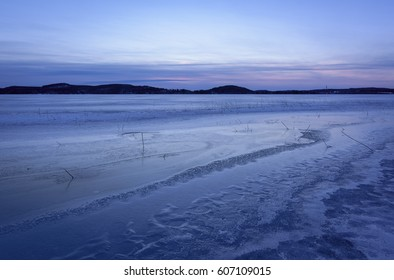 Frozen lake scenery in march