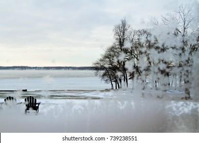 Frozen lake seen through frosty window