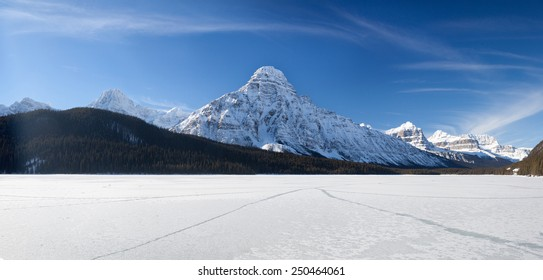 Frozen Lake and Snow Mountain in Canadian Rockies