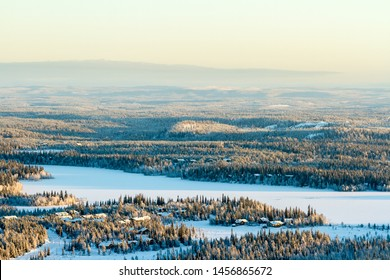 Frozen lake and snowy forest. Beautiful winter view in Finland, Ruka