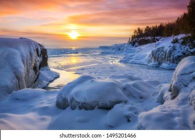 Frozen Lake Superior  sunrise at Presque Isle Park, Winter in Marquette, Michigan.