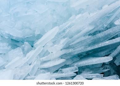 Frozen landscape scene - Huge blue ice hummocks on frozen lake