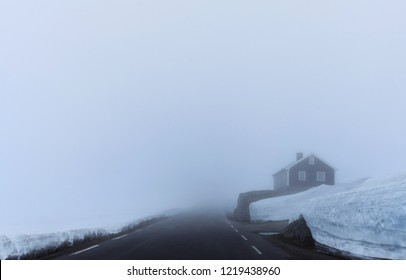 Frozen lonely house in the middle of nowhere in the winter. Heavy fog and a lot of snow.