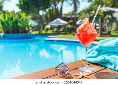 Frozen Margarita or Daiquiry cocktail near the pool. Vacation, summer, holiday, luxury resort concept. Living coral shade drink - color of the year. Horizontal
