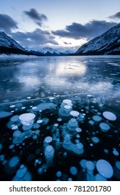 Frozen methane bubbles underneath Spray lake near Canmore, Alberta, Canada are the result of decaying organic matter.