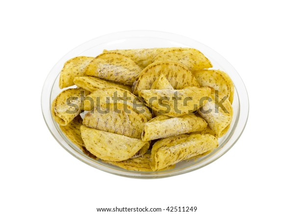 Frozen Mexican chicken/beef mini tacos on plate; isolated, clipping path included