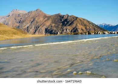 Frozen mountain lake in Val di Scalve, Alps montains, Italy