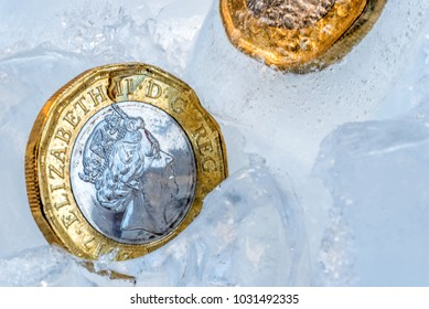 Frozen New British one pound sterling coin up close macro inside ice cubes