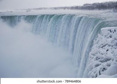 Frozen Niagara Falls. Ice, Snow, and Mist. Cold Canadian Winter. Niagara River. Winter Wonderland. Icicles.
