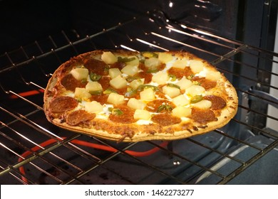 Frozen pizza on rack in home oven