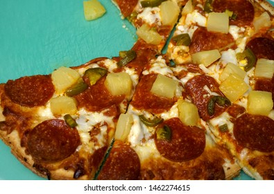 Frozen pizza with pineapple and pepperoni