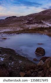 A frozen pond during dawn in Vernon BC