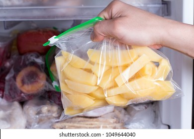 Frozen potatoes in a bag in the freezer. Frozen food
