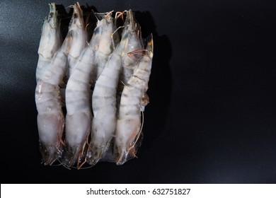 Frozen prawn on black background.