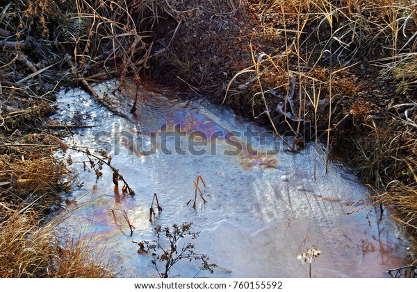 Frozen Puddle Gasoline Stains Environment Pollution Stock Photo
