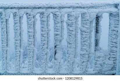 A frozen railing on top of the Buchkogelwarte in Burgenland, Austria