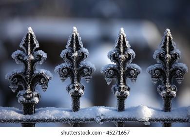 Frozen railings outside graveyard