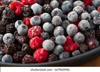 frozen raspberries, blackberries and blueberries close up