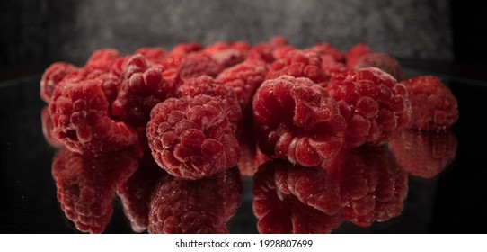 Frozen raspberries in close-up - food photography