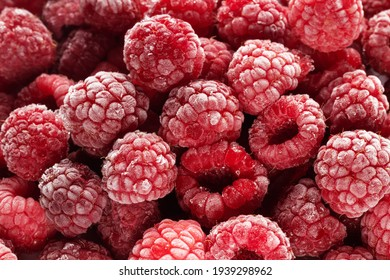 Frozen raspberries covered with hoarfrost. Berries background.