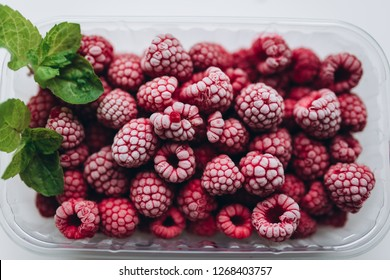 Frozen raspberries with fresh mint