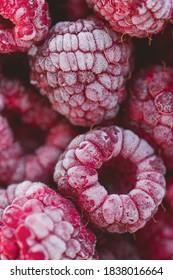 Frozen raspberries fruits, organic and vegan food. macro berries background. close up, top view