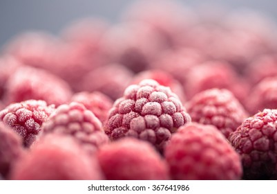 frozen raspberry on dark background