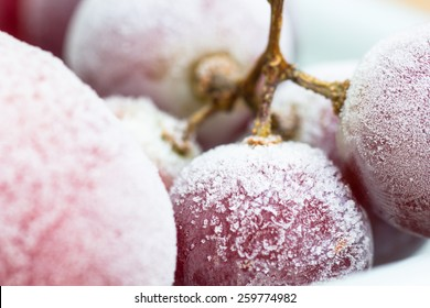Frozen red grapes A white flake ice,