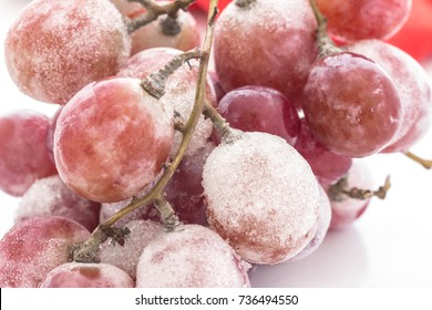 Frozen red grapes white flake ice,With the change from summer to autumn.