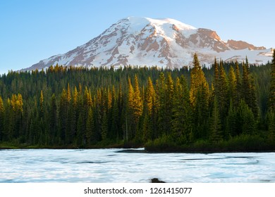 Frozen Reflection Lake and  Mount Rainier at sunrise, Mount Rainier National Park, Washington State, USA