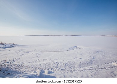 frozen reservoir in the snow
